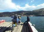 Bike crossing Lake Titicaca on a very dodgy barge on route to Copacabana.