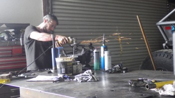 Bashing, hacking and grinding the fairing sub frame back into shape at Moab 4x4 Outpost.