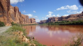 River turned red with storm waters. Moab Utah